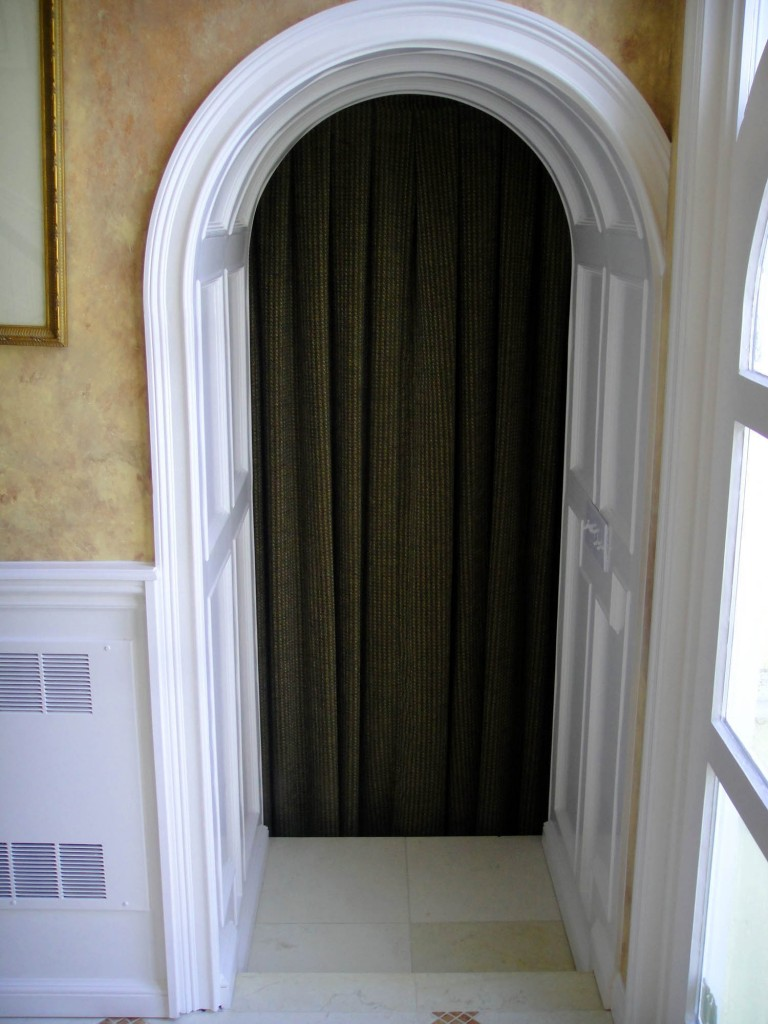 Paneled Arched Hallway 768x1024 Architectural Detailing for a Foyer