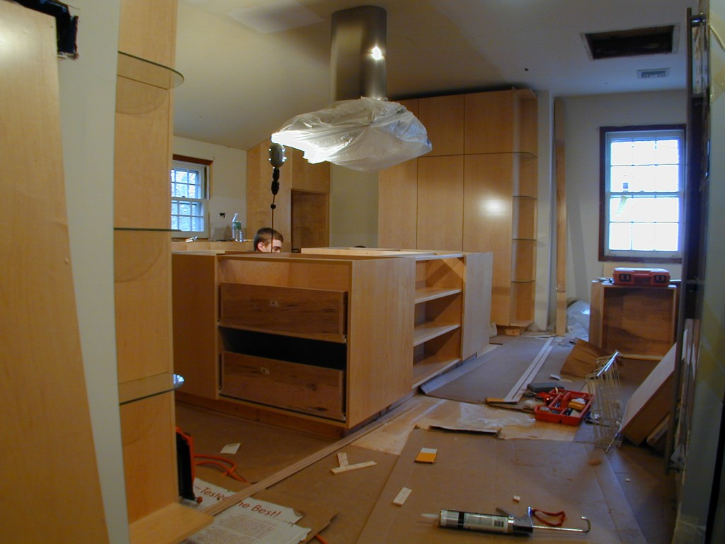 modern kitchen island being installed