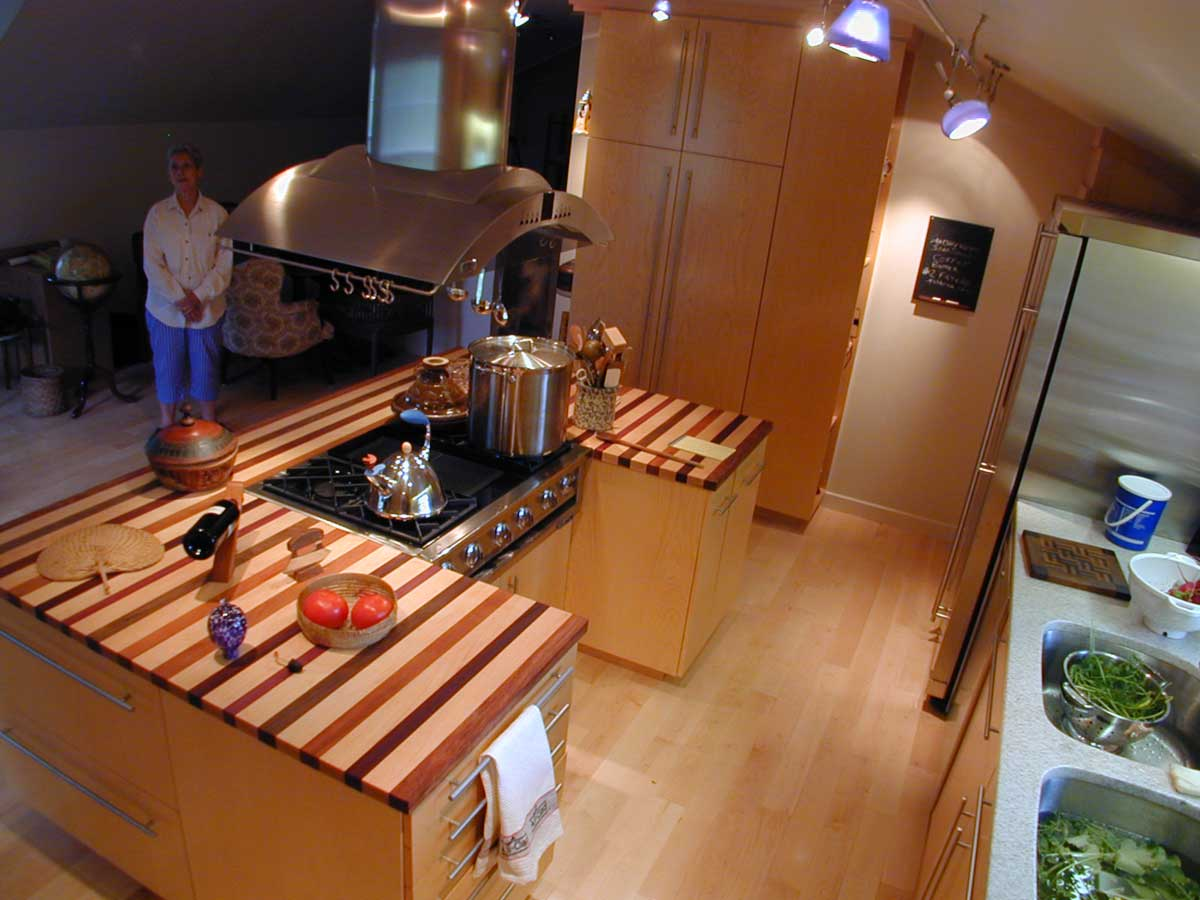 dinner being made 11 Stunning Photos of Kitchen Track Lighting
