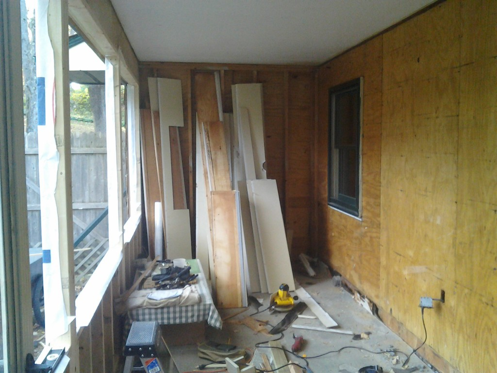 removed clapboard 1024x768 Making a Sunroom (From a Screened in Porch)